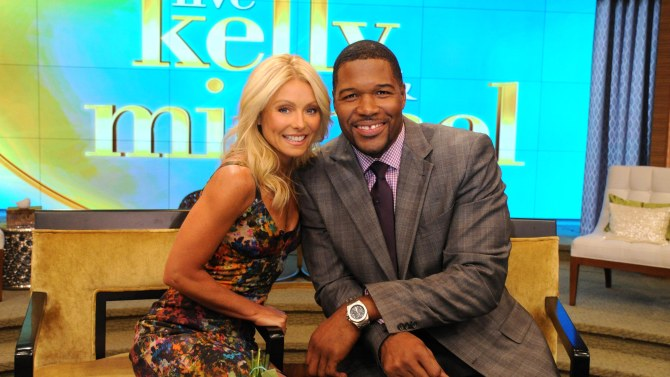 "LIVE WITH KELLY AND MICHAEL - NEW YORK, NY – September 4, 2012 – Months of rumor and speculation ended this morning as Kelly Ripa proudly introduced legendary NFL star sports broadcaster Michael Strahan as her new co-host during the inaugural broadcast of the newly-rechristened syndicated talk show, LIVE! with Kelly and Michael,"" distributed by Disney-ABC Domestic Television. (Disney-ABC/ {DAVE RUSSELL)"